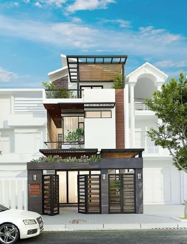 Thiết kế mảng kính chạy dọc tầng 2 và 3 giúp ngôi nhà thêm độc lạ hơn