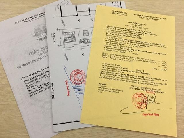 Bạn nên đến ủy ban nhân dân để được điều chỉnh giấy phép xây dựng