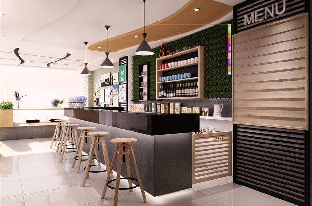 Quán café có phong cách thiết kế hiện đại, nhỏ nhắn và xinh xắn với những bộ bàn ghế màu sắc tươi tắn