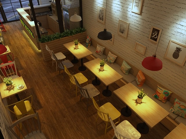 Quán trà sữa có trang trí thêm những khung ảnh và những chiếc gối tựa đầy màu sắc mang đến cảm giác mới lạ cho khách hàng