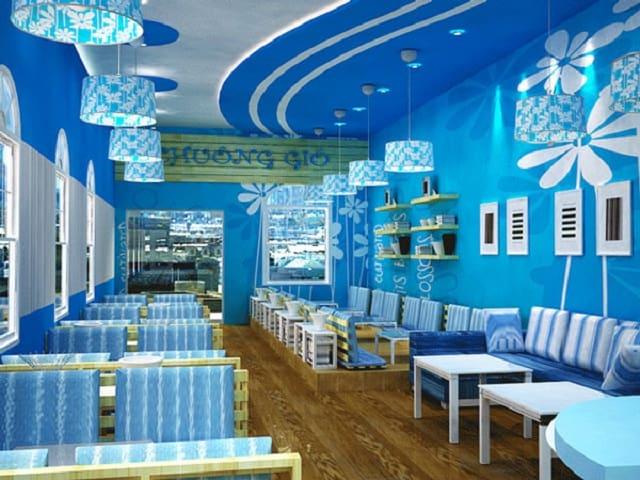 Quán trà sữa lựa chọn phông nền màu xanh nước biển kết hợp với trắng tạo thành một không gian ấn tương, tươi mới